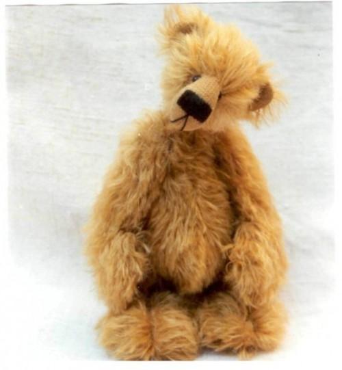 Грустный медвежонок игрушка мягкая